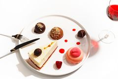 Gourmet desserts on a white plate. Top view stock photography