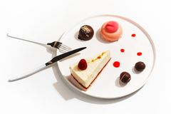 Gourmet desserts on a white plate. Top view royalty free stock photos