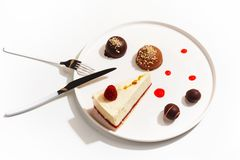 Gourmet desserts on a white plate. Top view stock photos
