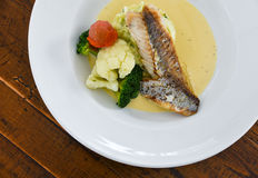Gourmet dinner bass fillet plate Royalty Free Stock Images