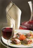 Gourmet dinner with a glass of red wine. Decanter and napkin stock images