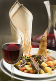 Gourmet dinner with a glass of red wine. Decanter and napkin dining royalty free stock images