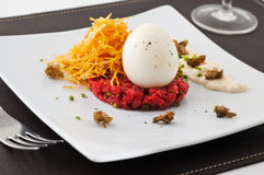 Gourmet dish with egg and raw meat. Royalty Free Stock Photos