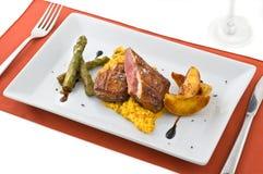 Gourmet dish with meat. stock photos