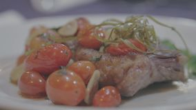 Gourmet Dish Meat with cherry tomato. Gourmet dish with delicious roast beef with cherry tomato stock footage