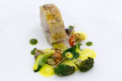 Gourmet dish on a white plate. Food background. Royalty Free Stock Photography