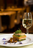 Gourmet dish and white wine. Stock Images