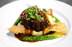 Gourmet filet on bed of mashed potatoes Royalty Free Stock Images