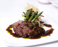 Gourmet fillet mignon steak. A gourmet fillet mignon steakshot from above  served at five star restaurant Royalty Free Stock Image