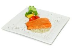 Gourmet fish - salmon steak. On white stock photos