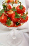 Gourmet Food. Cherry tomatoes with cheese in a bowl Stock Images