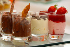 Gourmet Food. Three kinds of chocolate desserts with strawberries and vanilla Royalty Free Stock Photos