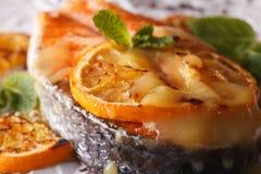 Gourmet Food: Baked salmon steak with orange macro. horizontal Stock Images