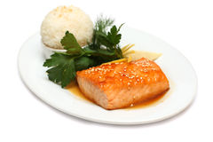 Gourmet food - fish steak. On white royalty free stock images