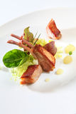 Gourmet food lamb ribs. Gourmet lamb ribs white plate Stock Image