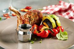 Pork Loin with Grilled Vegetables and Sauce. Gourmet Food - Pork Loin with Grilled Vegetables and Sauce Stock Photos