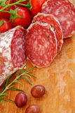 Gourmet food - salami, olives and herbs Royalty Free Stock Photography