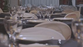 Gourmet food salon Wine glasses. Living room with tables prepared for gourmet dishes and bright glasses stock footage