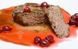 Gourmet food - steak in cherry sauce Royalty Free Stock Photos