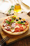 Gourmet four seasons with all the toppings. Gourmet Italian four seasons pizza with all the toppings including prosciutto ham, olives, mushrooms, chees, tomato Royalty Free Stock Photo
