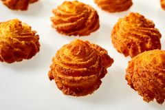 Gourmet fried potato cakes in twirled spirals stock photos