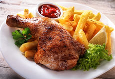 Gourmet Fries and Chicken Dish on a Plate Stock Images