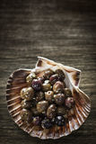 Gourmet garlic marinated fresh olives tapas snack starter Stock Photography
