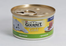 Gourmet Gold pet food cans on white background Royalty Free Stock Photo