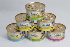 Gourmet Gold pet food cans on white background Royalty Free Stock Photos