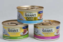 Gourmet Gold pet food cans on white background Stock Images
