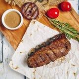 Beef Steak Dinner. Gourmet Grill Restaurant Steak Menu - Tri-Tip Beef Steak on Wooden Background. Black Angus Prime Beef Steak. Beef Steak Dinner. Top VIew stock photography