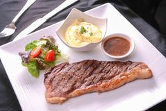 Gourmet Grill Steak. And salad royalty free stock photography