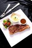 Gourmet grill Steak. And salad Royalty Free Stock Photos