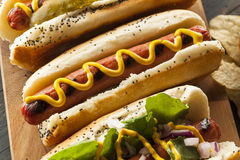 Gourmet Grilled All Beef Hots Dogs. With Sides and Chips Royalty Free Stock Photography