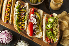 Gourmet Grilled All Beef Hots Dogs. With Sides and Chips Royalty Free Stock Photos