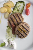 Gourmet Grilled beefburger with poached potatoes 7top view stock photo