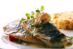 Gourmet grilled fish served with prawns Stock Photo