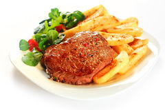 Gourmet Grilled Meat with French Fries on Plate Royalty Free Stock Images
