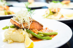 Gourmet Grilled Salmon Steak. With baked potato and lemon meal stock photo