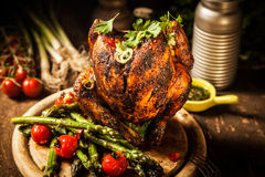 Gourmet Grilled Whole Beer Can Chicken on Wooden Board Stock Photos