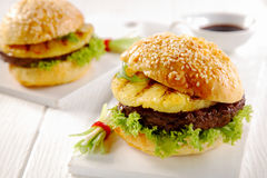 Gourmet Hawaiian Burgers Served on White Table Stock Images