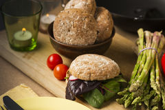 Gourmet Healthy Food with Bread and Veggies. Close up Gourmet Healthy Food with Bread and Veggies on Wooden Board, Emphasizing Leafy Vegetables, Asparagus and stock photos