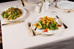 Gourmet Healthy Tasty Dishes on White Plates Stock Photography