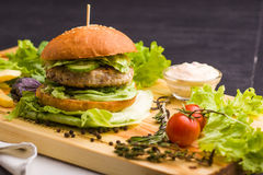 Free Gourmet Homemade Burger With Garnish Stock Images - 70906284