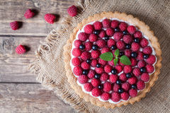 Gourmet homemade raspberry tart pie. Traditional Stock Images