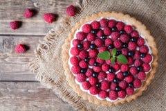 Gourmet homemade raspberry tart pie. Traditional Stock Images