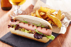 Gourmet hot dog on slate board Royalty Free Stock Photos