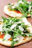 Gourmet individual pizzas with lots of rocket Stock Photography