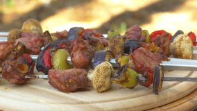 Gourmet, juicy barbecue on ooden chopping board stock video