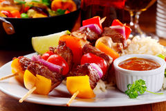 Gourmet Kebab Dish on Plate with Tomato Sauce Stock Photo